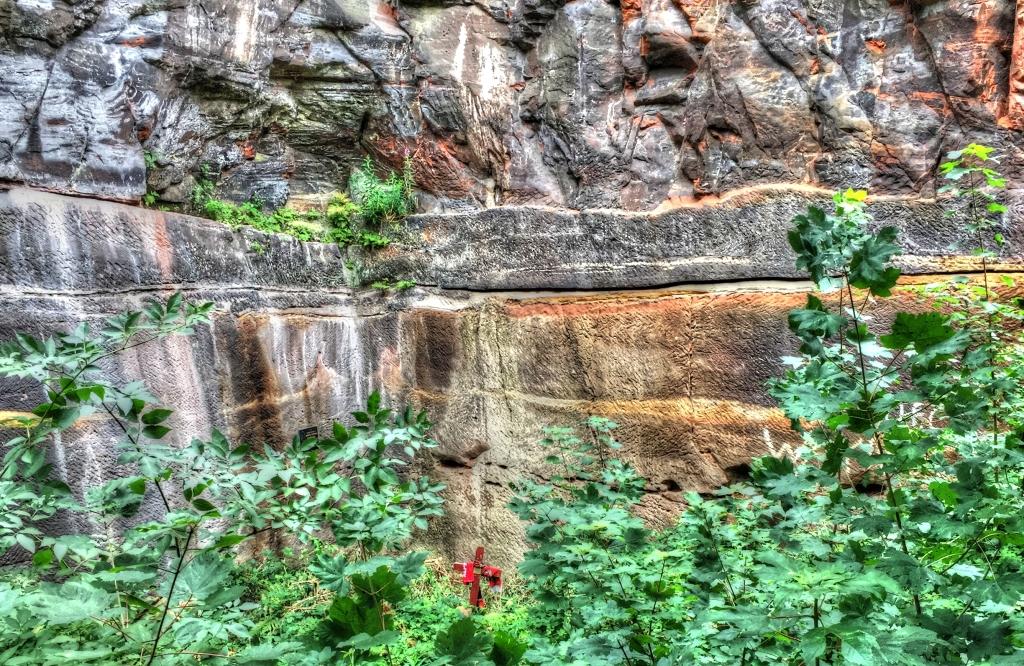 cross at bottom of cliff
